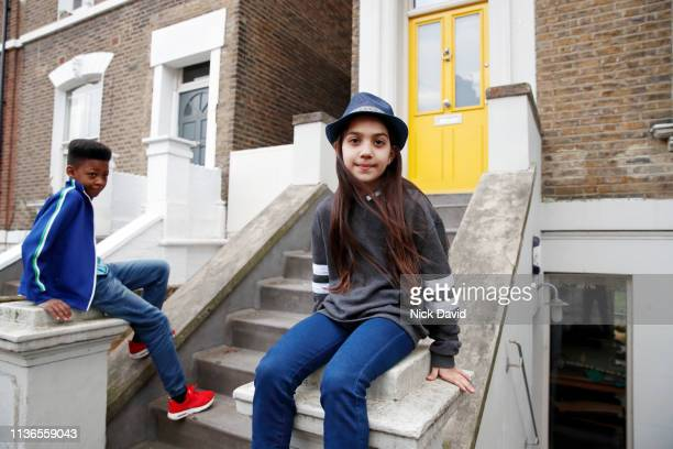 Boy and girl waiting outside front door