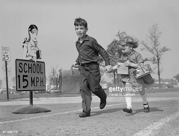 boy and girl walking on road - {{relatedsearchurl(carousel.phrase)}} stock pictures, royalty-free photos & images