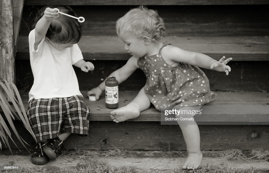 Boy and girl wand : Stock Photo