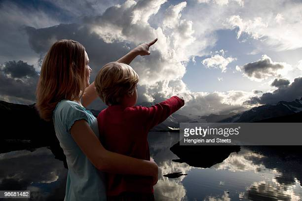boy and girl watching the sky - bottomless girl stock pictures, royalty-free photos & images