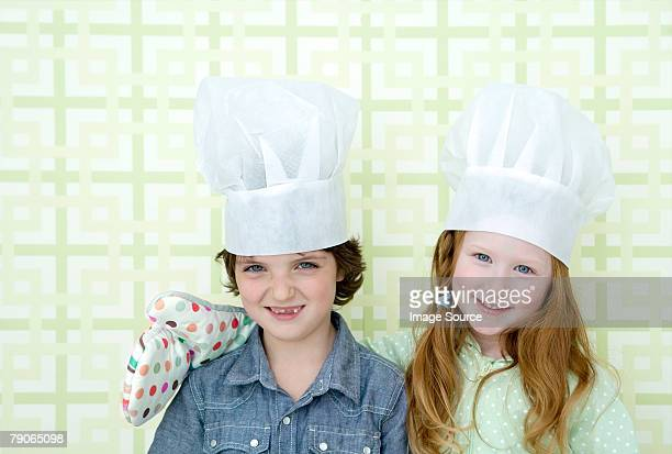 Boy and girl wearing chef hats