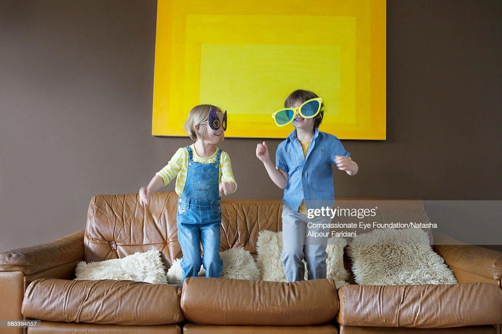 Boy and girl wearing oversized sunglasses and mask : Stock Photo