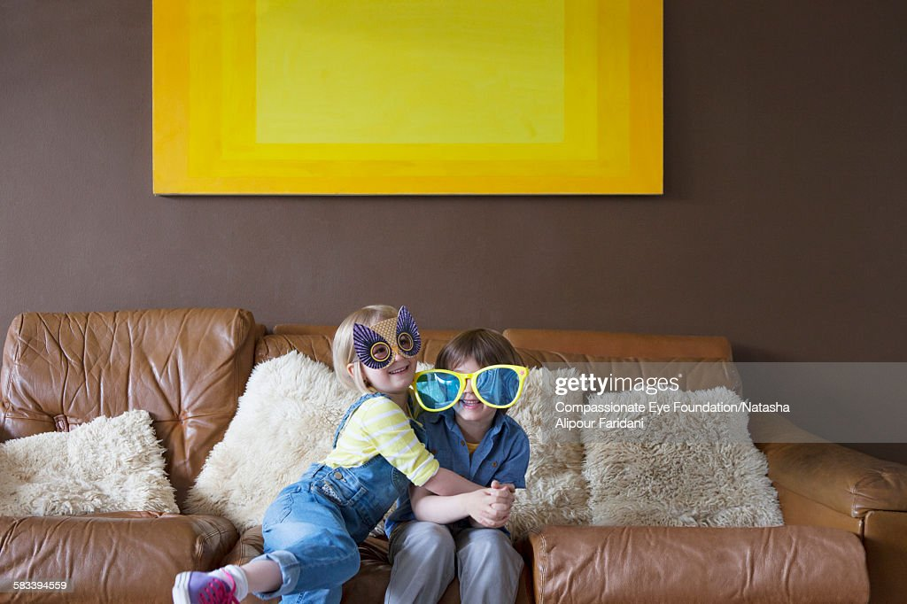Boy and girl wearing oversized sunglasses and mask : Stock Photo