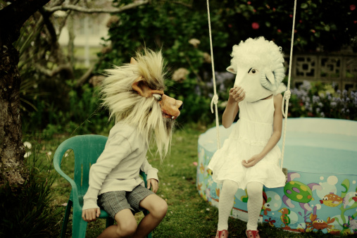 Boy and girl wearing wolf and sheep mask - gettyimageskorea