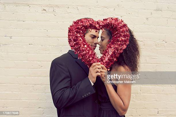 boy and girl with a valentine heart - valentines african american stock pictures, royalty-free photos & images