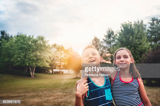 boy and girl with arms around each other