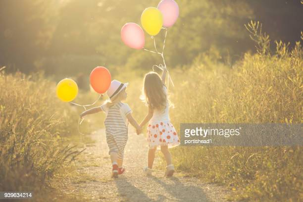 Boy and girl with balloons