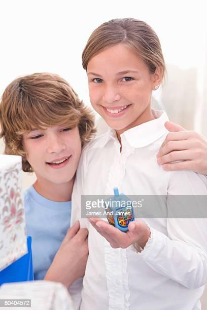 Boy and girl with dreidel