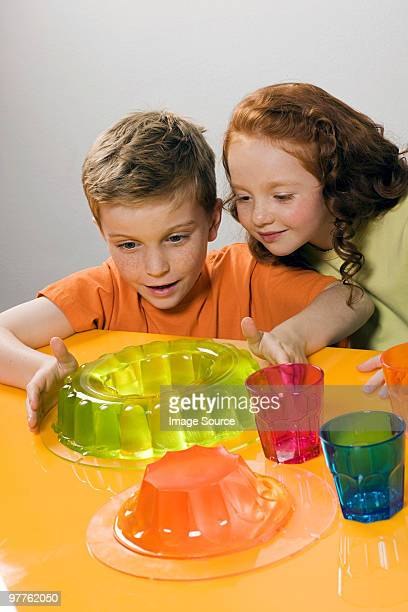 boy and girl with jellies - gelatin dessert stock photos and pictures