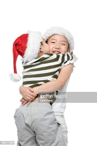 Boy and girl with Santa hats