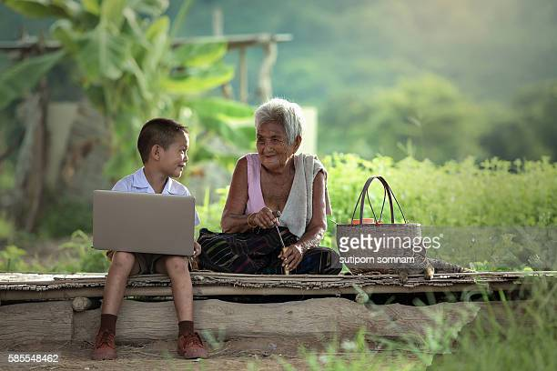 A boy and grandmother with a laptop