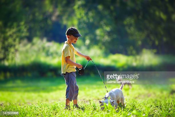 boy and his dog - pedal pushers stock pictures, royalty-free photos & images