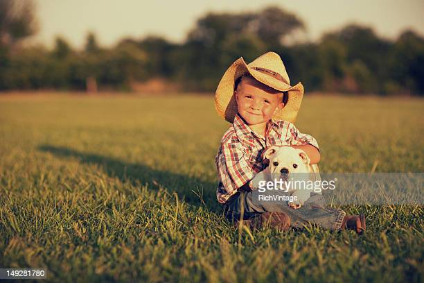 boy and his dog - cowboy hat stock pictures, royalty-free photos & images