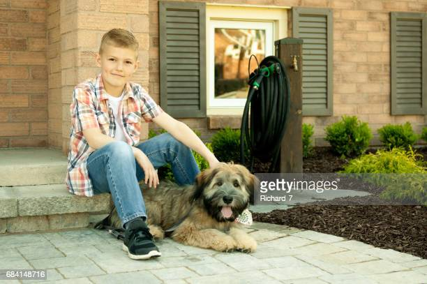 a boy and his dog - soft coated wheaten terrier stock photos and pictures