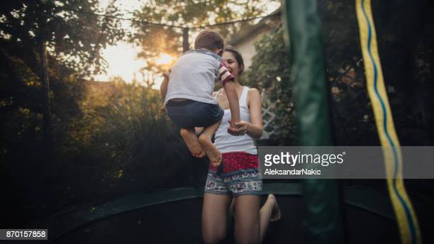 Boy and his mom on a trampoline