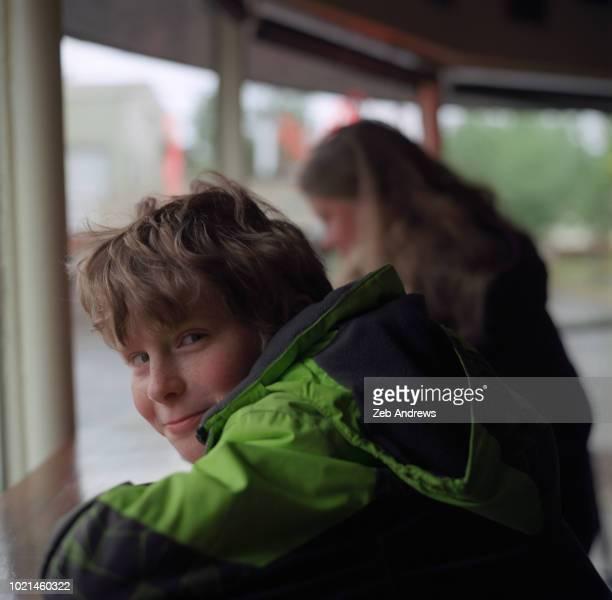 Boy and his mom sitting in a local coffee shop, Portland, Oregon