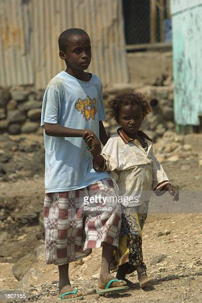 A boy and his sister walk through the BaalBalla slum February 21 2003 in the outskirts of Djibouti Town Djibouti BaalBalla is one of many Djibouti...