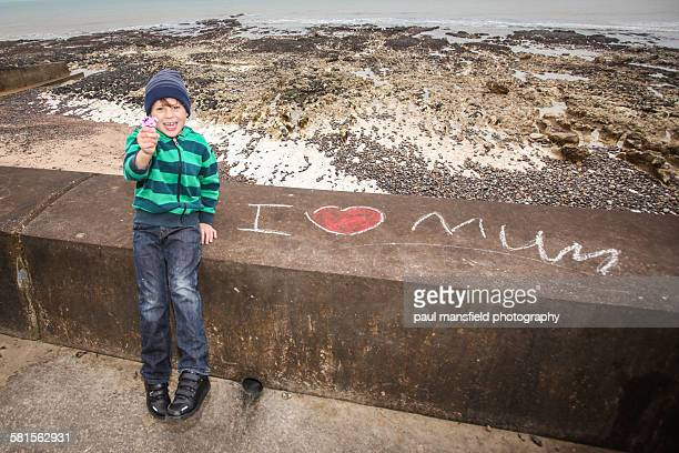 Boy and 'I Love Mum' message
