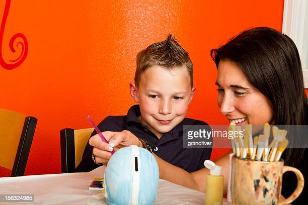 Boy and Mom Painting Pottery