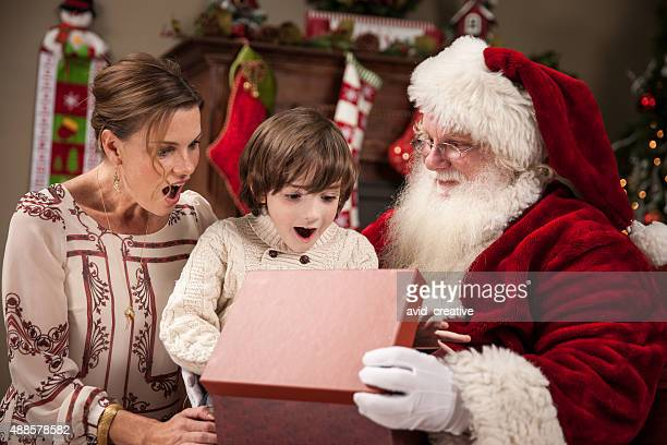 Boy and Mother Open Gift With Santa