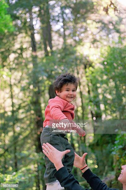 Boy and parent in forest
