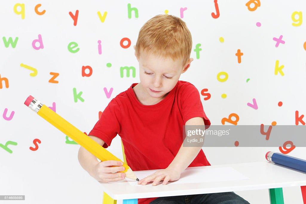 Boy and pencil