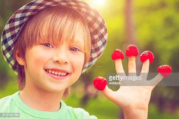 Boy and raspberry