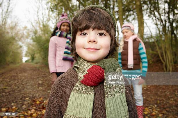 Boy and two girls on country lane