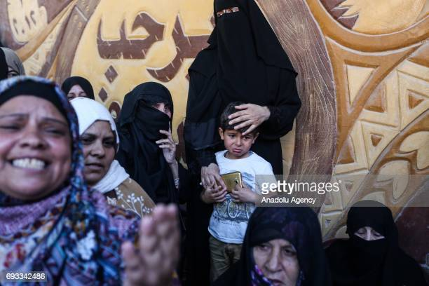 A boy and women mourn during the funeral ceremony of 25yearold Fadi Ibrahim enNeccar who was shot dead by Israeli forces during his funeral ceremony...