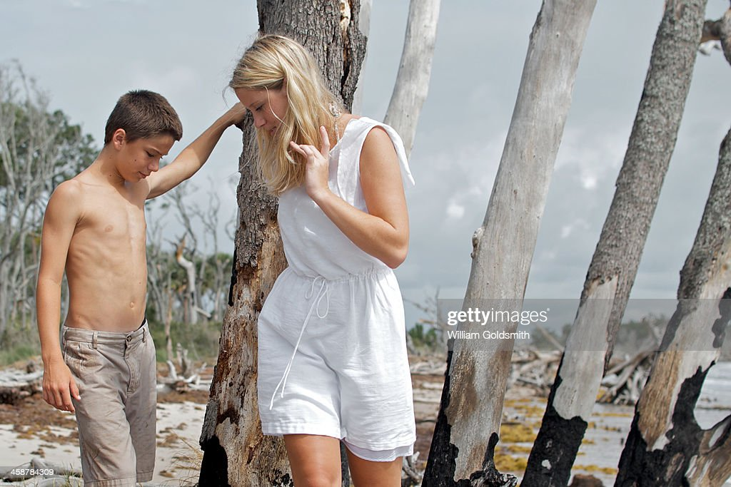 Boy And Young Woman Exploring Driftwood Stock Photo -1610
