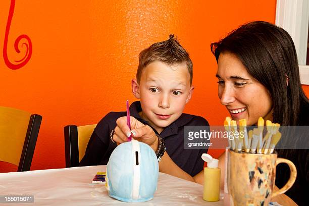 Boy and YoungMom Painting Pottery