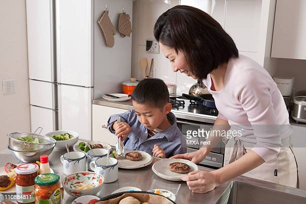 Boy Arranging Dishes on Plate
