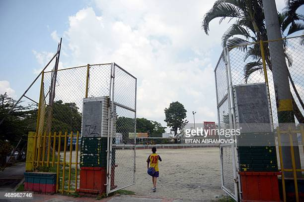 A boy arrives at the Academia Tolimense de Futbol field where Real Madrid football club player Colombian James Rodriguez used to train in Ibague...