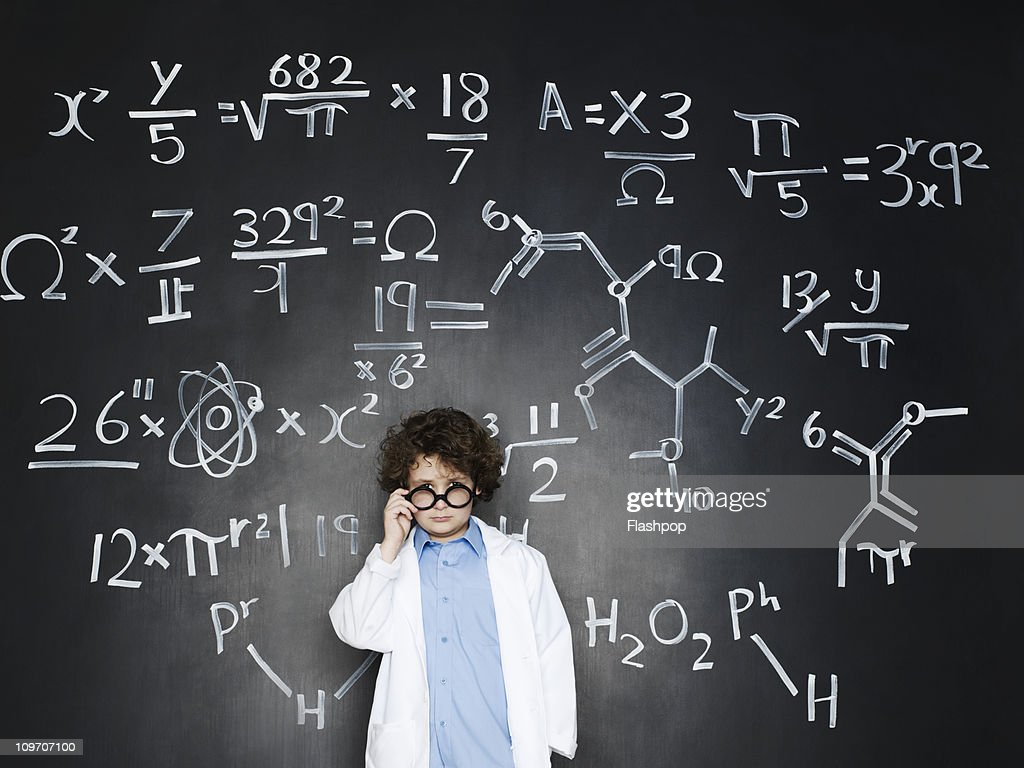 Boy as a professor with formulas behind him : Stock Photo