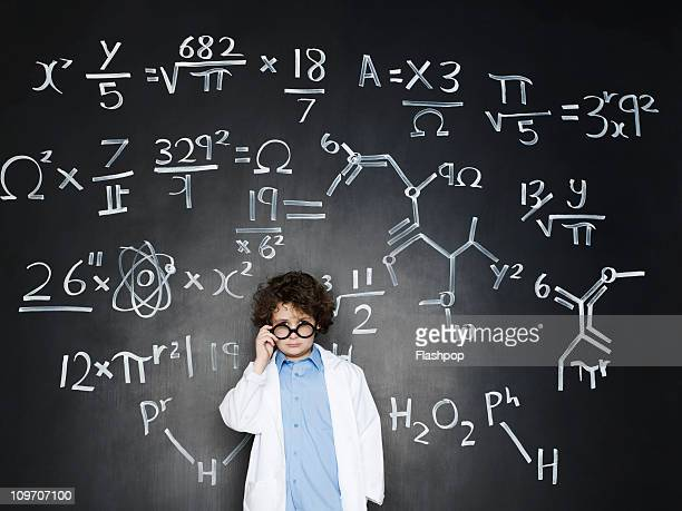 boy as a professor with formulas behind him - intelligence stock pictures, royalty-free photos & images