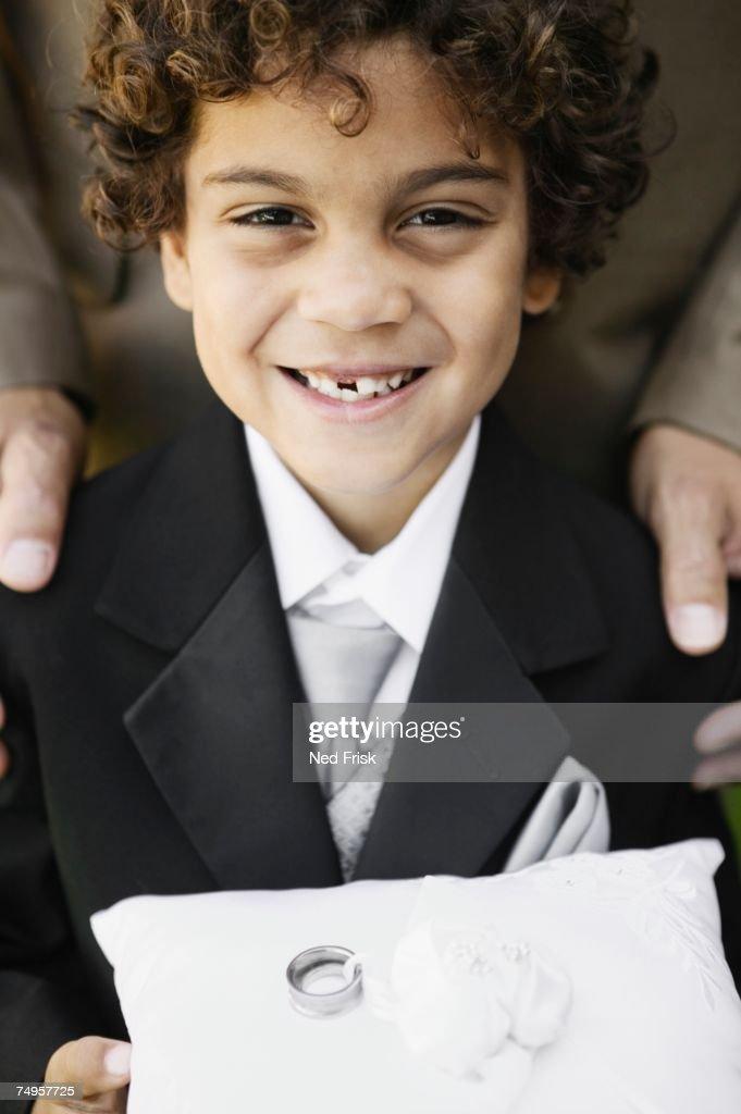 Boy as ring bearer at wedding : Stock Photo