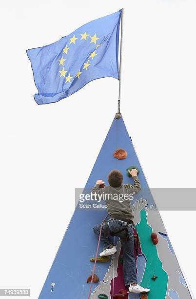A boy ascends a climbing wall with a map of the European Union at an EU sponsored promotional event June 28 2007 in Berlin Germany The European Union...