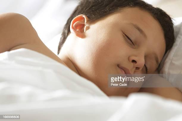 Boy asleep in bed