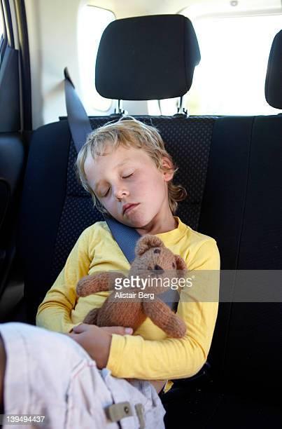 Boy asleep in car