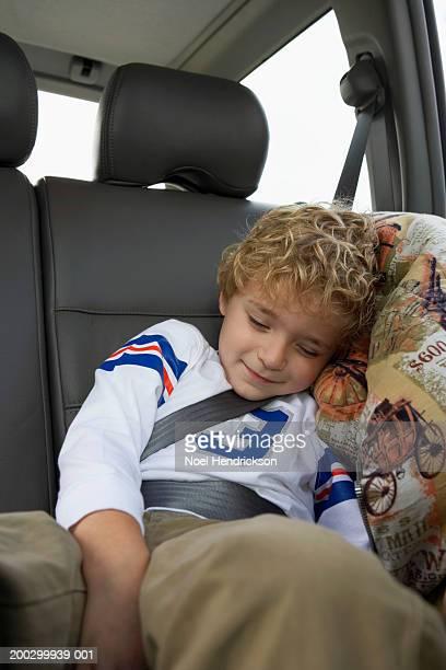Boy (5-7 years) asleep on rear seat of car, close-up