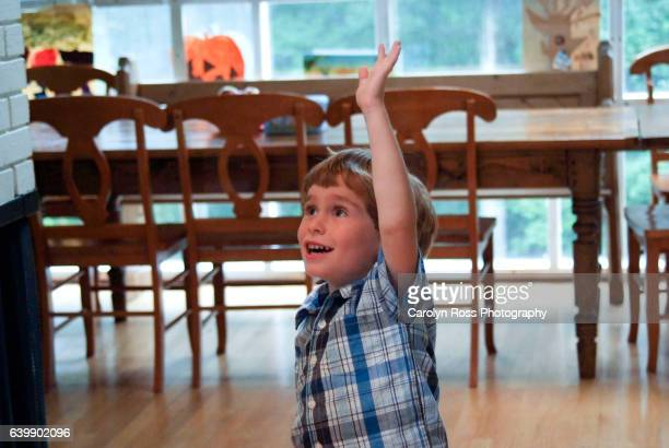 boy at a birthday party - carolyn ross stock pictures, royalty-free photos & images