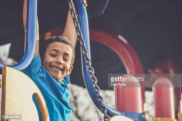boy at a park. - playground stock pictures, royalty-free photos & images