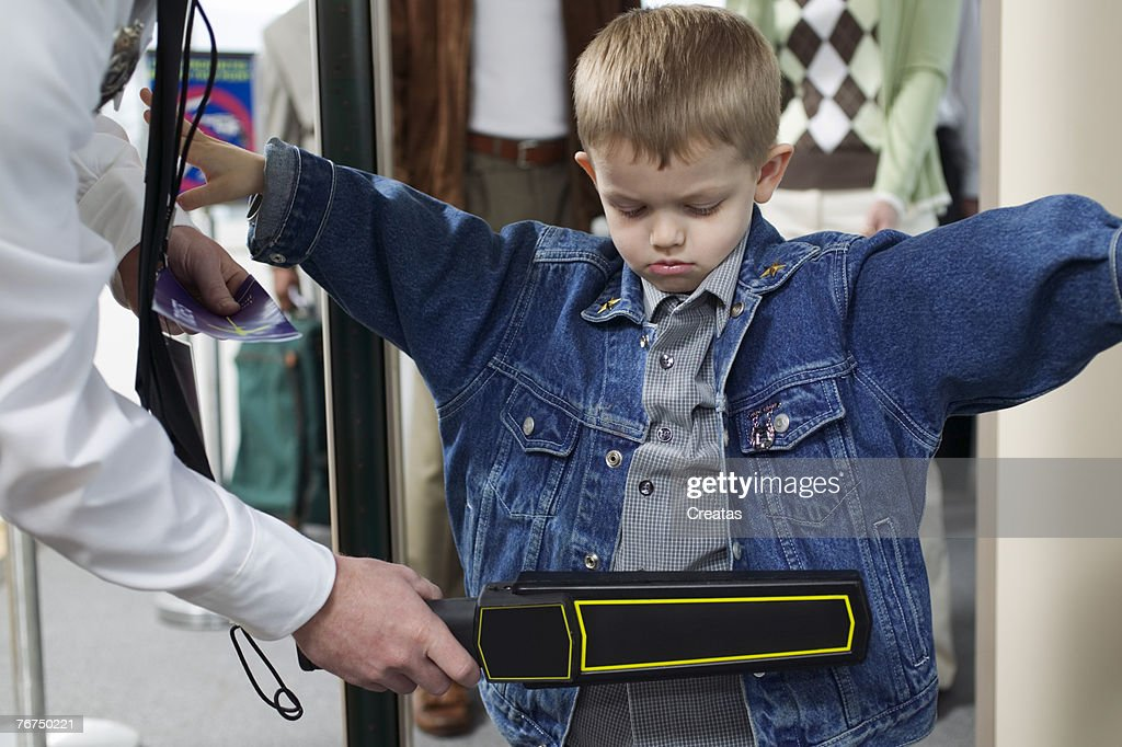 Boy at an airport security checkpoint : Stock Photo