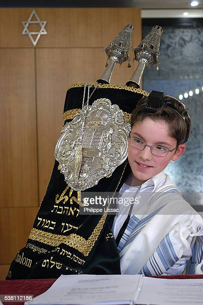 Boy at Bar Mitzvah with Torah Scrolls