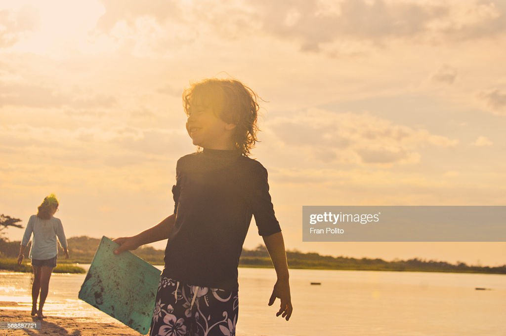 Boy at bay on a warm summer day. : Stock Photo