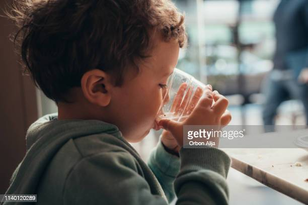 boy at coffee shop - drinking water stock pictures, royalty-free photos & images