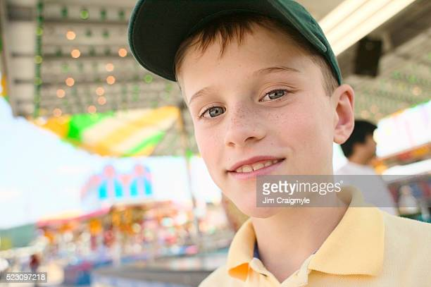 boy at fun fair - jim craigmyle stock pictures, royalty-free photos & images