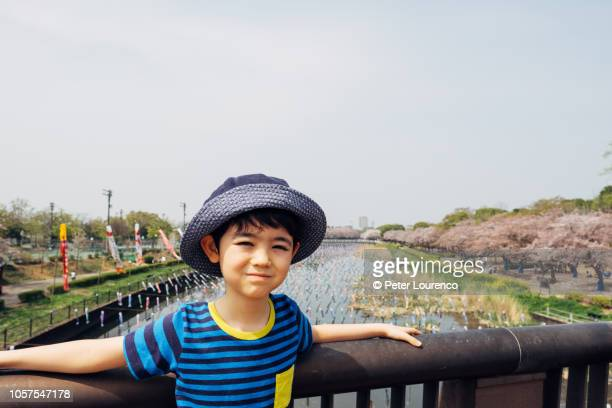 Boy at Japanese park in Springtime.