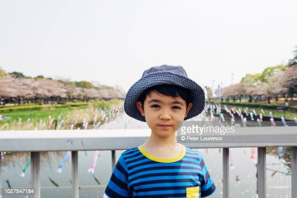 boy at japanese park in springtime. - peter lourenco stock pictures, royalty-free photos & images