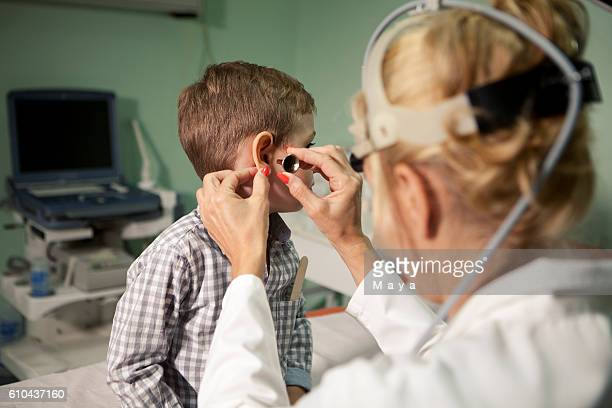 Boy at otolaryngologist's office